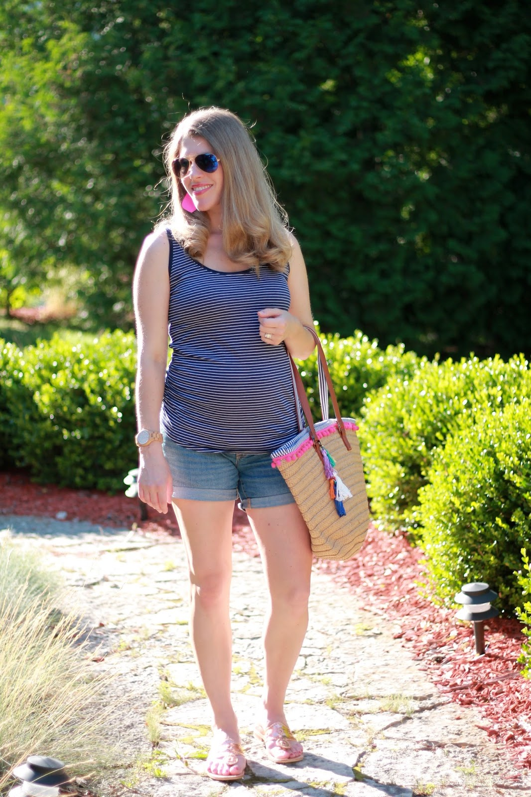 navy striped tank, jean shorts, pom pom straw tote, Jack Rogers rose gold sandals, neon pink leather earrings, second trimester maternity