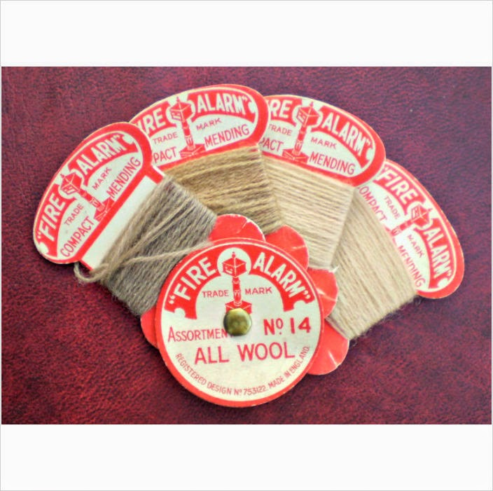 http://uk.ebid.net/for-sale/4-vintage-fire-alarm-all-wool-darning-thread-cards-assortment-no-14-charity-126199811.htm
