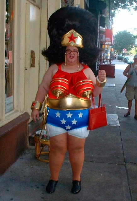 Plus size Superwoman on the street, Halarious costume completed with purse, and enoromouos wig. The Smell of Freedom and other stories about 'merica. marchmatron.com.jpg