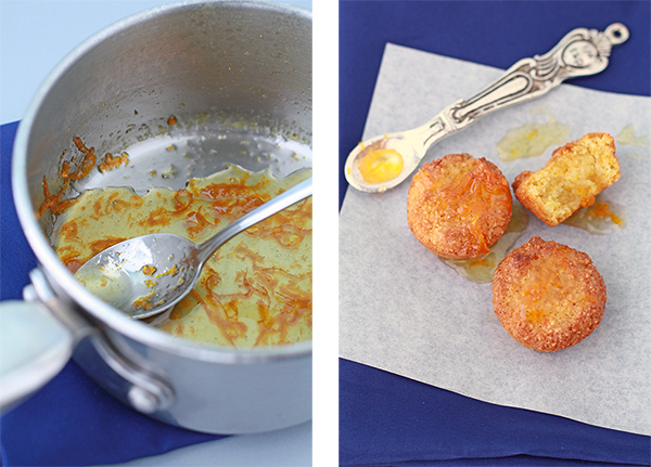 orange syrup made with orange zest and gluten-free orange almond cakes on parchment with spoon of syrup