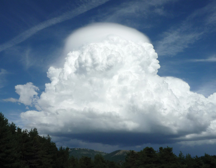Cumulonimbus cloud and pilleus, rare cloud formation