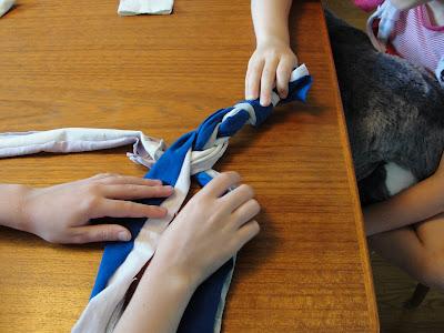 child braiding t-shirt strips