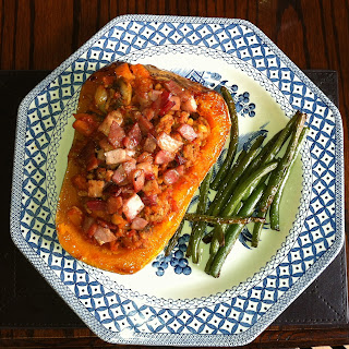 Pork Stuffed Butternut Squash with roasted green beans on a plate