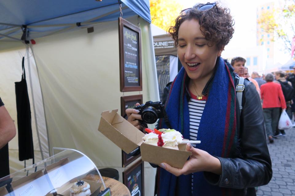 Food blogger with a pavlova at Salamanca Market, Tasmania