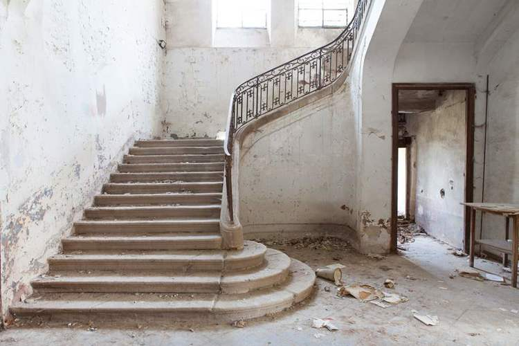 Decaying stone staircase in French Chateau Gudanes