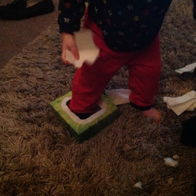 picture of toddler with foot in tissue box