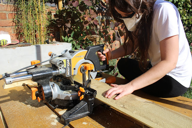 girl using mitre saw