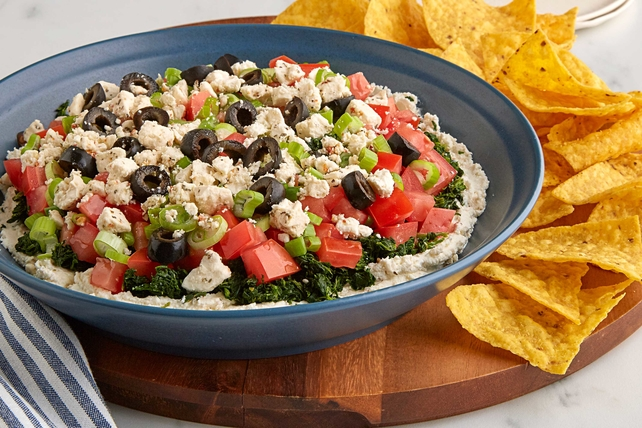 layer dip with beautiful colors and bold Mediterranean flavors Mediterranean Six Layer Dip Recipe
