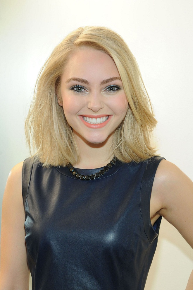 AnnaSophia Robb in a peplum top and skirt at The Today Show in New York