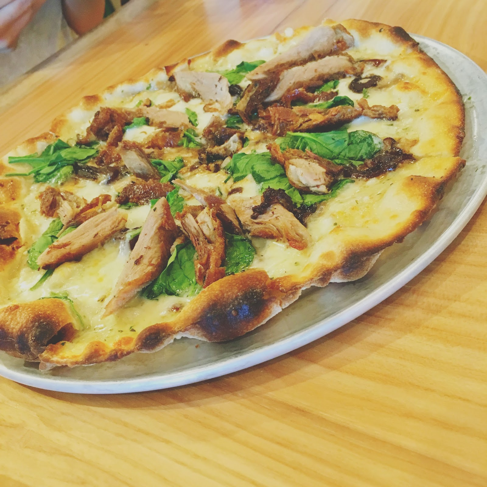 crispy duck pizza at H.S. Green - A healthy restaurant in Houston, Texas