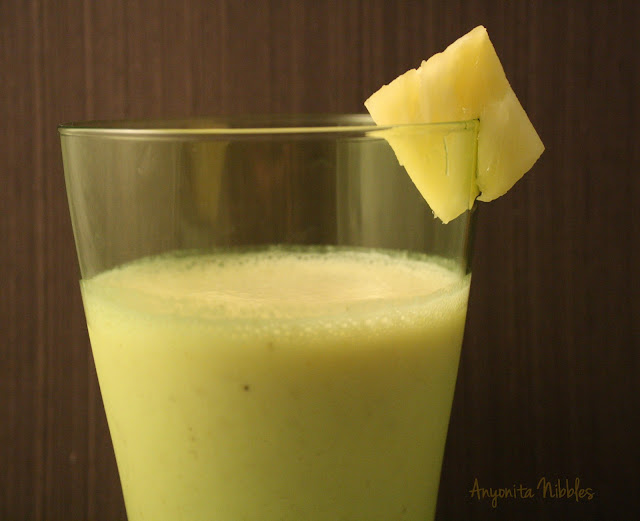 tropical smoothie: pineapple, mango Activia full fat yogurt, milk, ice, honey, banana