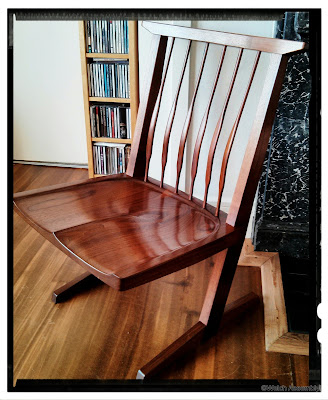 Image of a Nakashima style chair in american black walnut