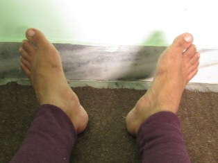 aA person's feet in Shava asan or Corpse pose