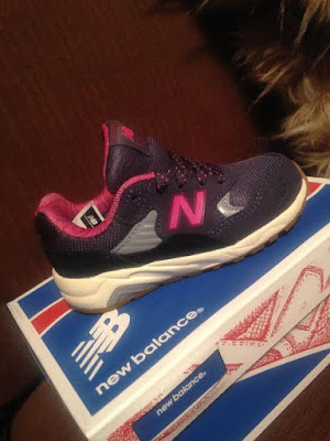Pink and gray New Balance kids sneakers