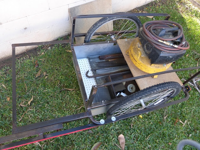bike trailer loaded with scrap metal