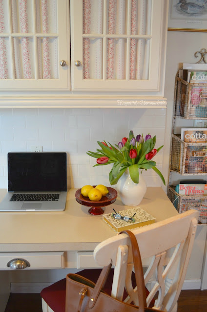 Kitchen desk with fabric on glass cabinets