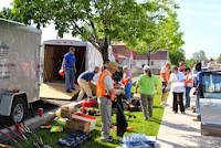 "Volunteers clean up Harrison Street using tools from the mobile lending ""library."""