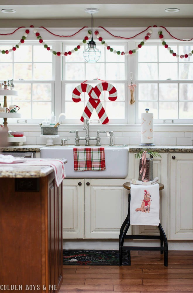 Whimsical and cheery Christmas decor in kitchen with farmhouse sink
