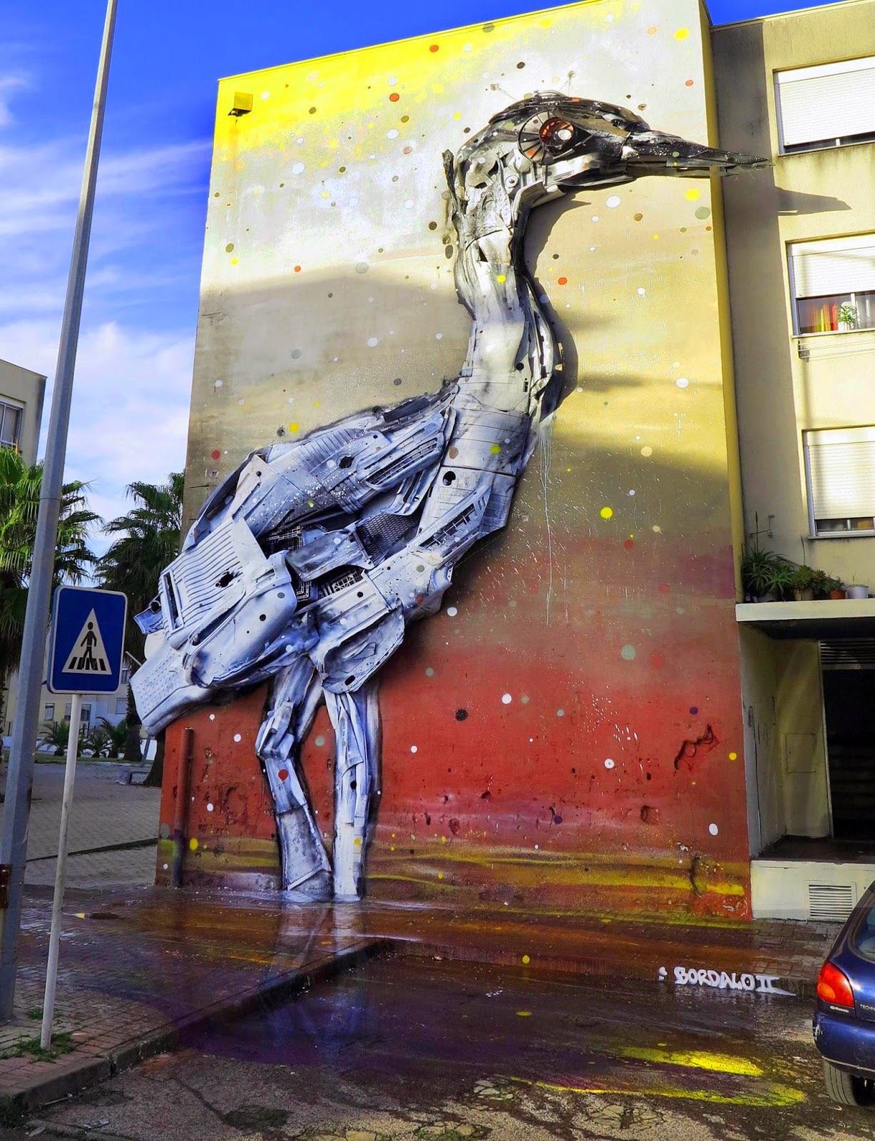 While we last heard from him a few days ago in Covilhã, Bordalo II is now in Loures, Portugal where he just finished working on this new street installation.