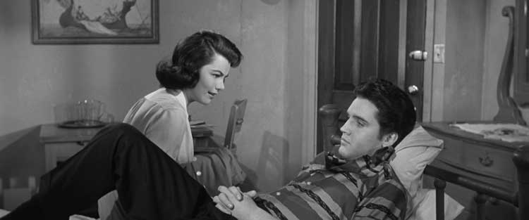 Elvis Presley and Judy Tyler have a warm moment in Jailhouse Rock.