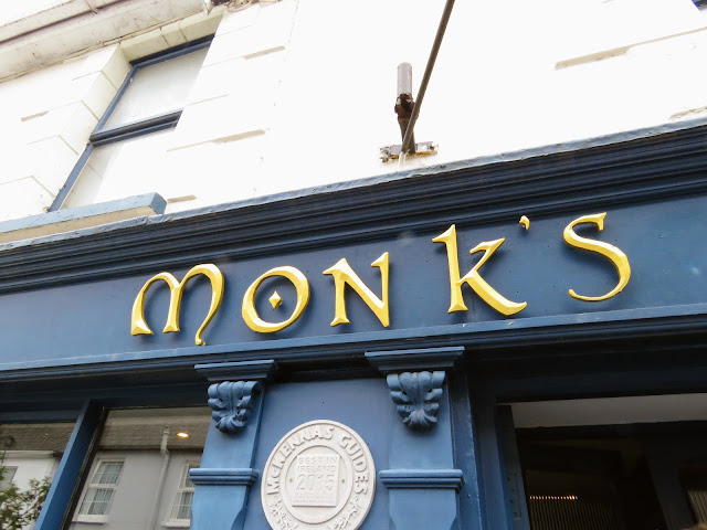 Best Places to Eat in Cork: Monk's Lane Bar and Restaurant Sign in the West Cork town of Timoleague