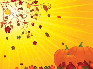 Clipart image of a Thanksgiving background with pumpkins and falling leaves