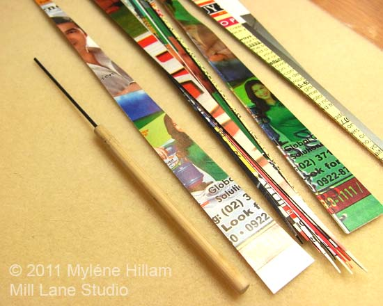 Magazine pages cut into strips and a bead rolling tool