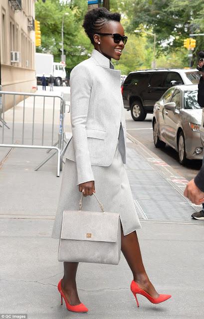 Lupita Nyong in Hugo Boss with Top Handle handbag