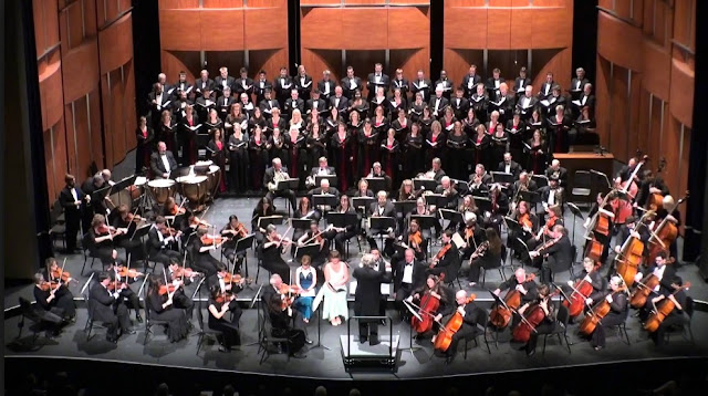 An orchestra with soloists and choir, performing Beethoven's Ninth Symphony