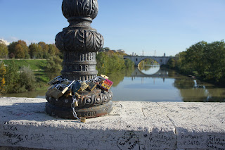 Padlocks - lucchetti dell'amore - attached to a lamppost  on the Ponte Milvio across the Tiber in Rome