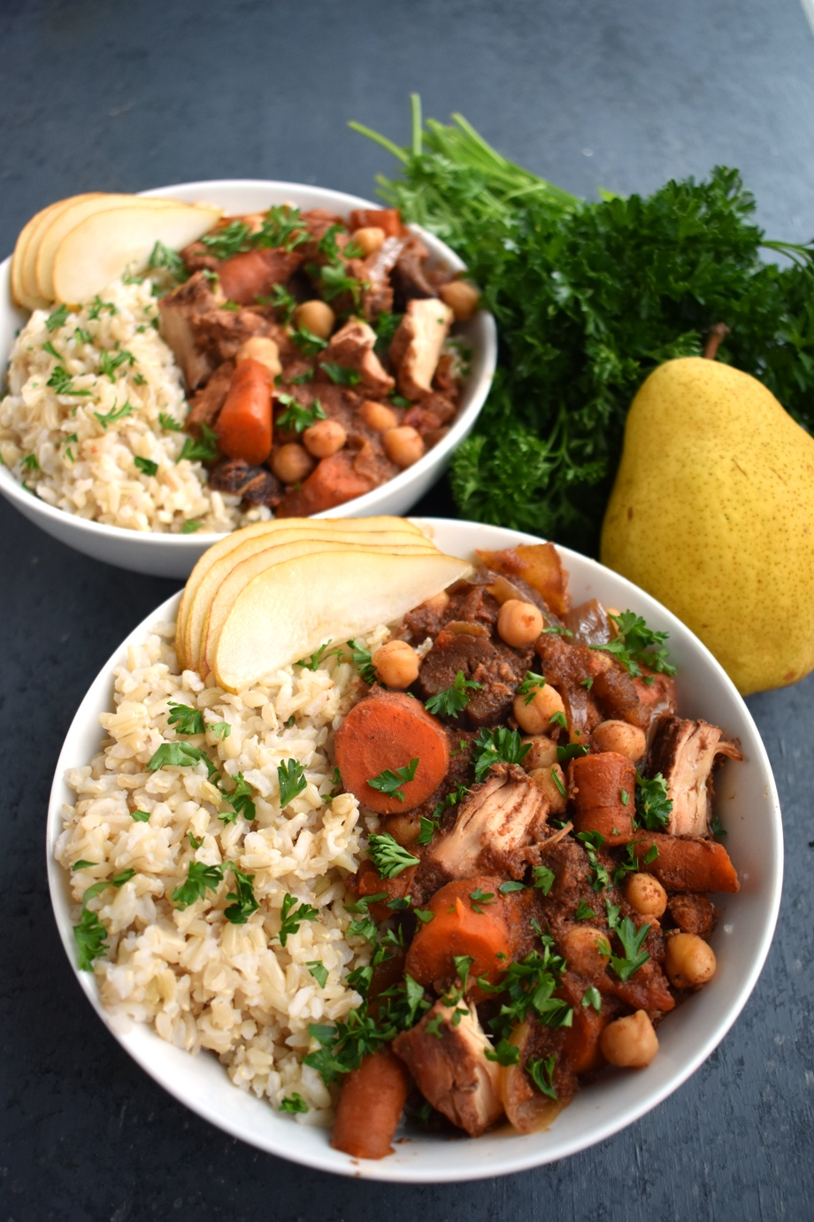 Slow Cooker Moroccan Chicken is loaded with flavor, tender chicken, carrots, chickpeas, pears, Moroccan spices and more for the perfect cozy meal! Serve over brown rice, cauliflower rice or quinoa. www.nutritionistreviews.com #healthy #cleaneating #dinner #slowcooker #chicken #crockpot