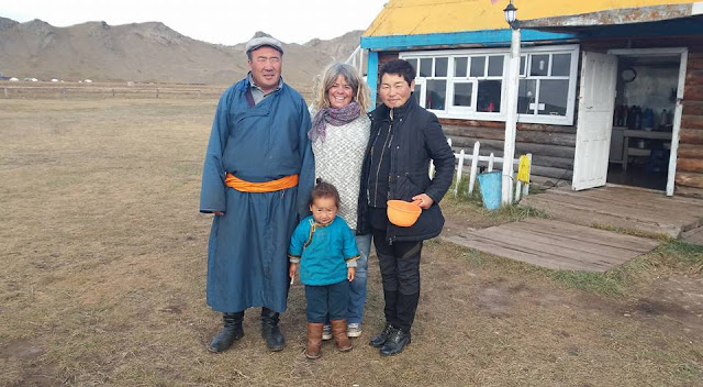 Our friends Batbold and Jargaa outside their home at Terkhiin Tsagaan Nuur, Mongolia