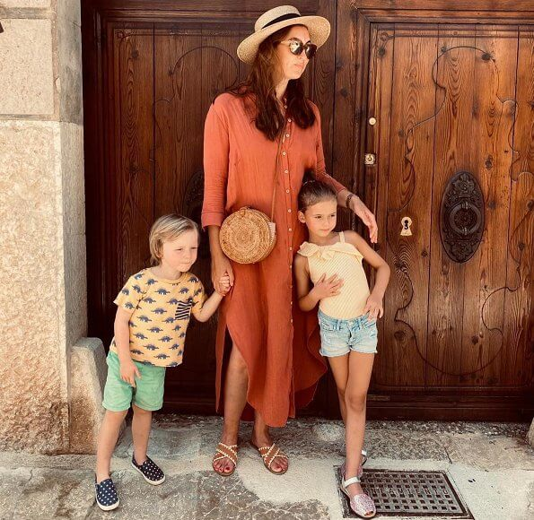 Princess Claire, Princess Amalia and Prince Liam. Princess Claire is wearing a Jane terracotta dress by the brand Young Empire