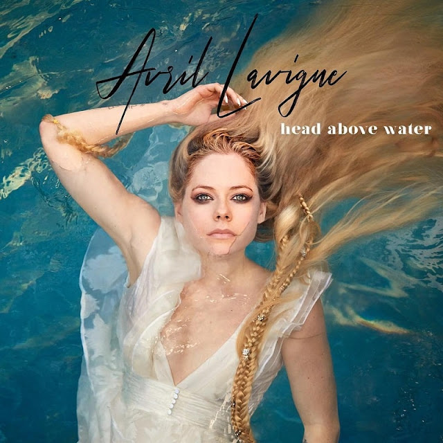 "Avril Lavigne Returns With Emotional Single ""Head Above Water"""
