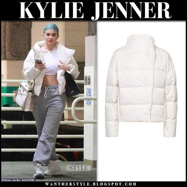 Kylie Jenner in white theory puffer jacket, grey sweatpants and white iro curve runner sneakers winter celebrity style january 3