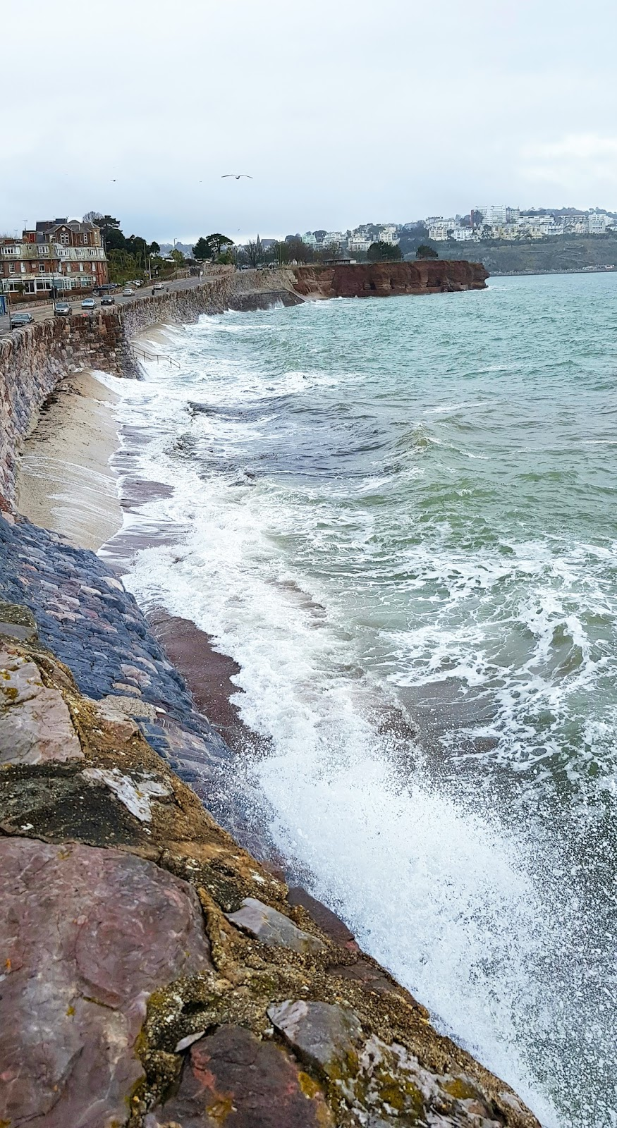 Image showing a rough sea breaking onto the beach at Torquay in Devon, March 2018
