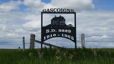 Gascoigne, Saskatchewan, Burstall, sign, school, Mendham, train