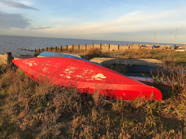 A red boat on the shore, Whitstable, Kent
