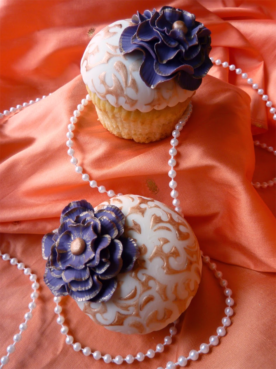 Vanilla cupcakes with textured fondant toppers and handmade ruffled flowers