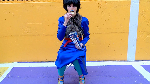 Melanie Kobayashi of Bag and a Beret, video still, eating chips