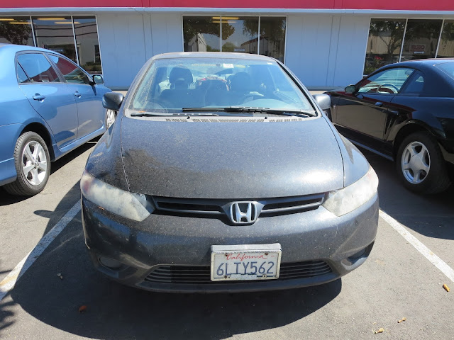 Dull looking Honda before getting new paint at Almost Everything Auto Body.
