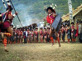 Naga dancers with spears and plumed headresses during the Horbill Festival.