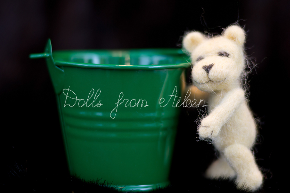 OOAK mini needle felted teddy bear standing next to bucket
