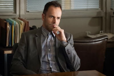 Jonny Lee Miller as Sherlock Holmes in CBS Elementary Season 2 Episode 9 On the Line