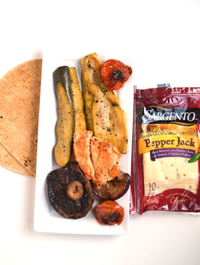 Marinated Grilled Chicken and Vegetable Wraps feature your marinated balsamic chicken and vegetables, hummus and pepper jack cheese in a whole-grain wrap for the perfect easy meal! www.nutritionistreviews.com