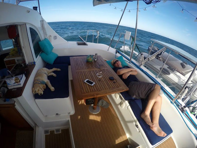 Napping in the cockpit of our Lagoon 380 on passage