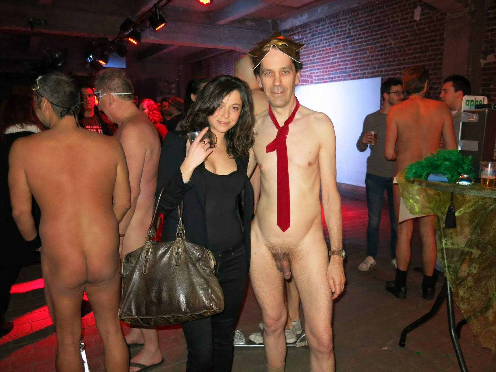 Embarrassed naked female clothed male