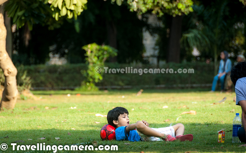 Many folks love to spend their leisure time in green lawns of Lodhi Gardens. Many kids, families, joggers etc can be seen in happy posture. Relaxing environment all around the Lodhi Garden, makes it a wonderful place to spend free time with your loved ones. Kid in above photograph was at garden with his father and both of them were relaxing after playing football. This kid was quite energetic, as he was not interested in any breaks but his father want him to take some drinks/snacks in between.