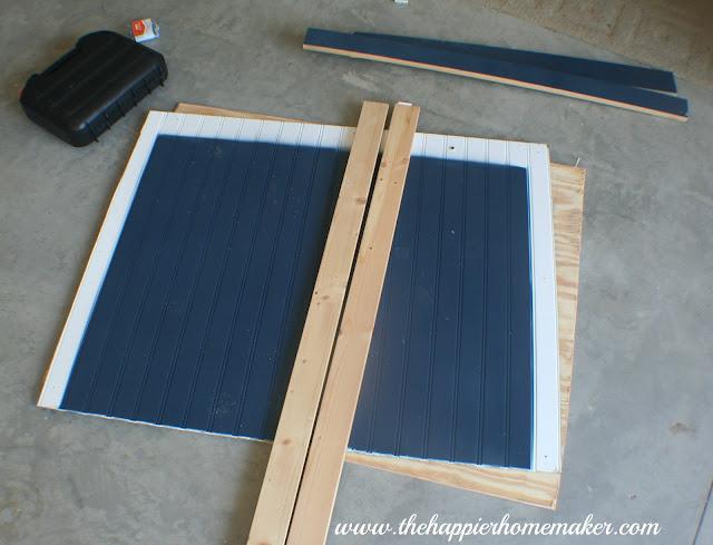 An in progress picture of making a DIY blue bead board headboard
