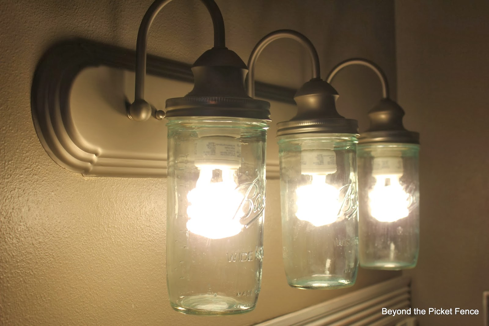 mason jar bathroom light fixture beyond the picket fence how to makeover a bathroom for 23747